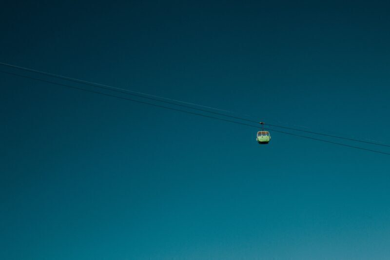 Green cable cart in a blue sky