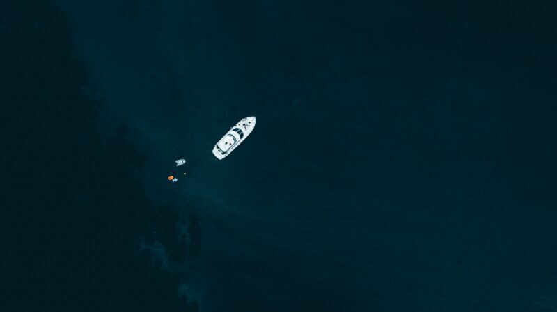 White ship in the middle of blue water body